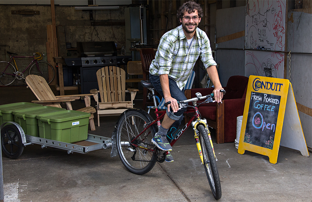 Jesse Nelson on his delivery bike. (Credit: Justin Steyer/KPLU)
