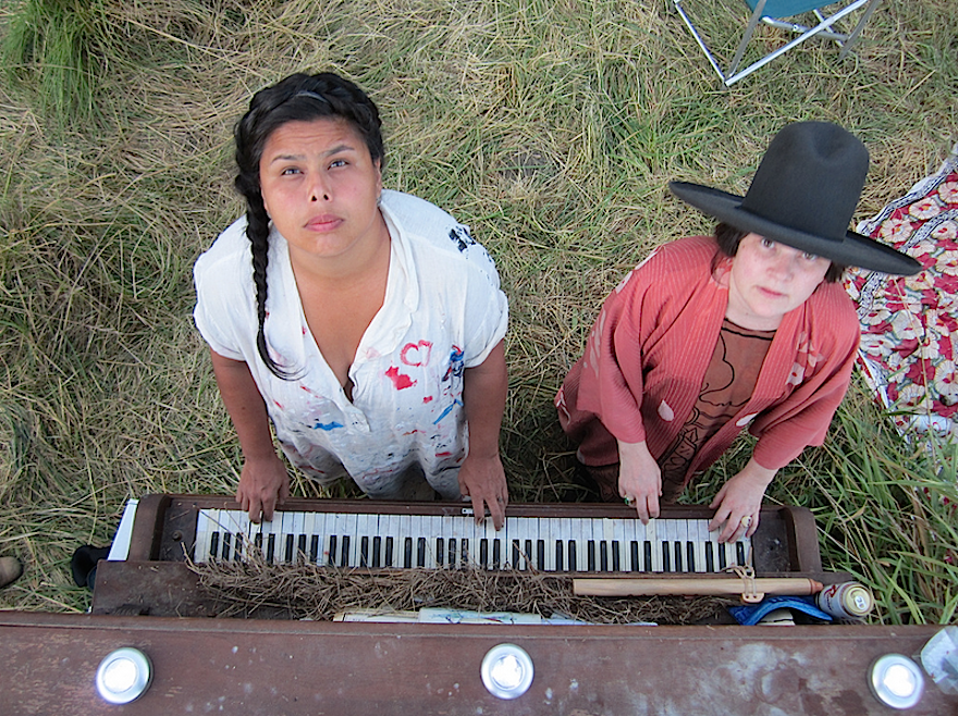 """Adria Garcia and Constance Awenasa rock the piano in the 'Braided Grass Village' by www.studiokabuya.com."" (Credit: zverina.com)"