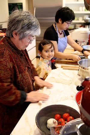 Three generations of the Chou family are busy at work, making dumplings. (Courtesy of Hsiao-Ching Chou)