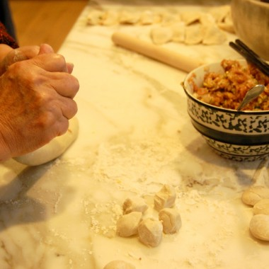 Ellen Chou kneads the dough and prepares it for rolling. (Martha Kang/KPLU)