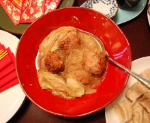Lion's head meatballs and Chinese cabbage with long noodles for longevity. (Martha Kang/KPLU)