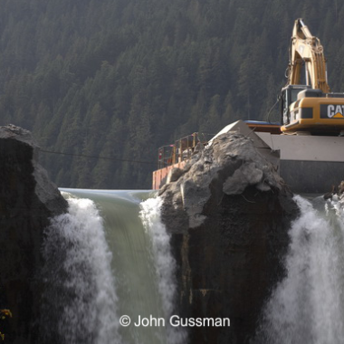 Crews chip away at the Glines Canyon Dam. (Courtesy of John Gussman)