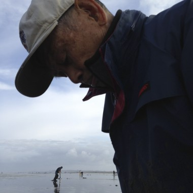 Toshio Inahara is a retired vascular surgeon from Portland. At 93 years old, he has five decades of razor clamming under his belt. (Rae Ellen Bichell/KPLU)