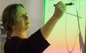 Cathy Iacobazzi walks inmates through a lesson about the human brain. (Justin Steyer/KPLU)