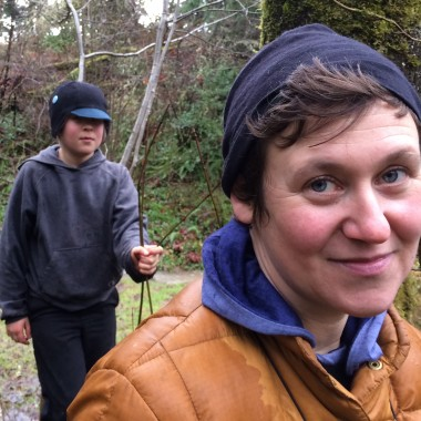 Nikki McClure smiles at the camera as her son, Finn, follows behind her. (Bellamy Pailthorp/KPLU)