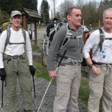 From left: Charlie Soncrant, Bruce Stobie and Ron Fleck prepare to hike the trail. (Neil Giardino/KPLU)
