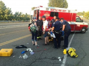 An injured rider was taken to the hospital in an ambulance. (Malcolm Griffes/KPLU)