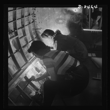 December 1942: Women riveters at the Boeing plant in Seattle work at assembly and fitting operations. (Andreas Feininger/Farm Security Administration)
