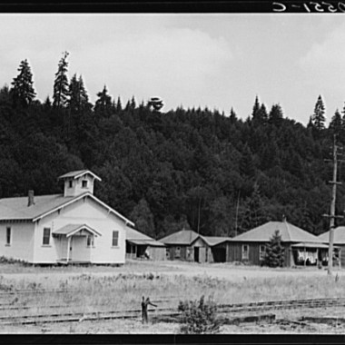 August 1939: The church closed when the mill closed, but the houses are again occupied in the abandoned mill village. Washington, Grays Harbor County, Malone. (Dorothea Lange/Farm Security Administration)