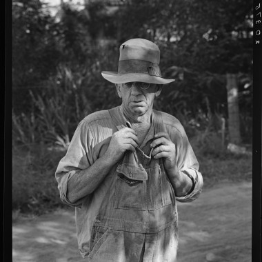 August 1939: Migratory worker in auto camp. (Dorothea Lange/Farm Security Administration)
