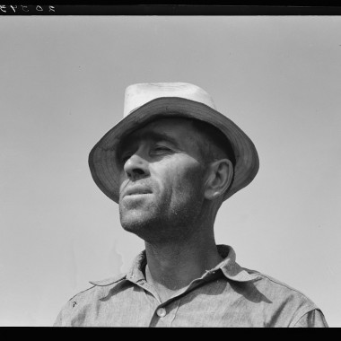 "August 1939: Washington, Yakima Valley, near Wapato. Rural rehabilitation client (Farm Security Administration). Portrait of Chris Adolf. ""My father made me work. That was his mistake, he made me work too hard. I learned about farming but nothing out of the books."" (Dorothea Lange/Farm Security Administration)"
