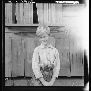August 1939: The youngest Arnold boy who also works at land clearing. Western Washington, Thurston County, Michigan Hill. (Dorothea Lange/Farm Security Administration)