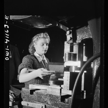 December 1942: Girl working on a machine. (Andreas Feininger/Farm Security Administration)
