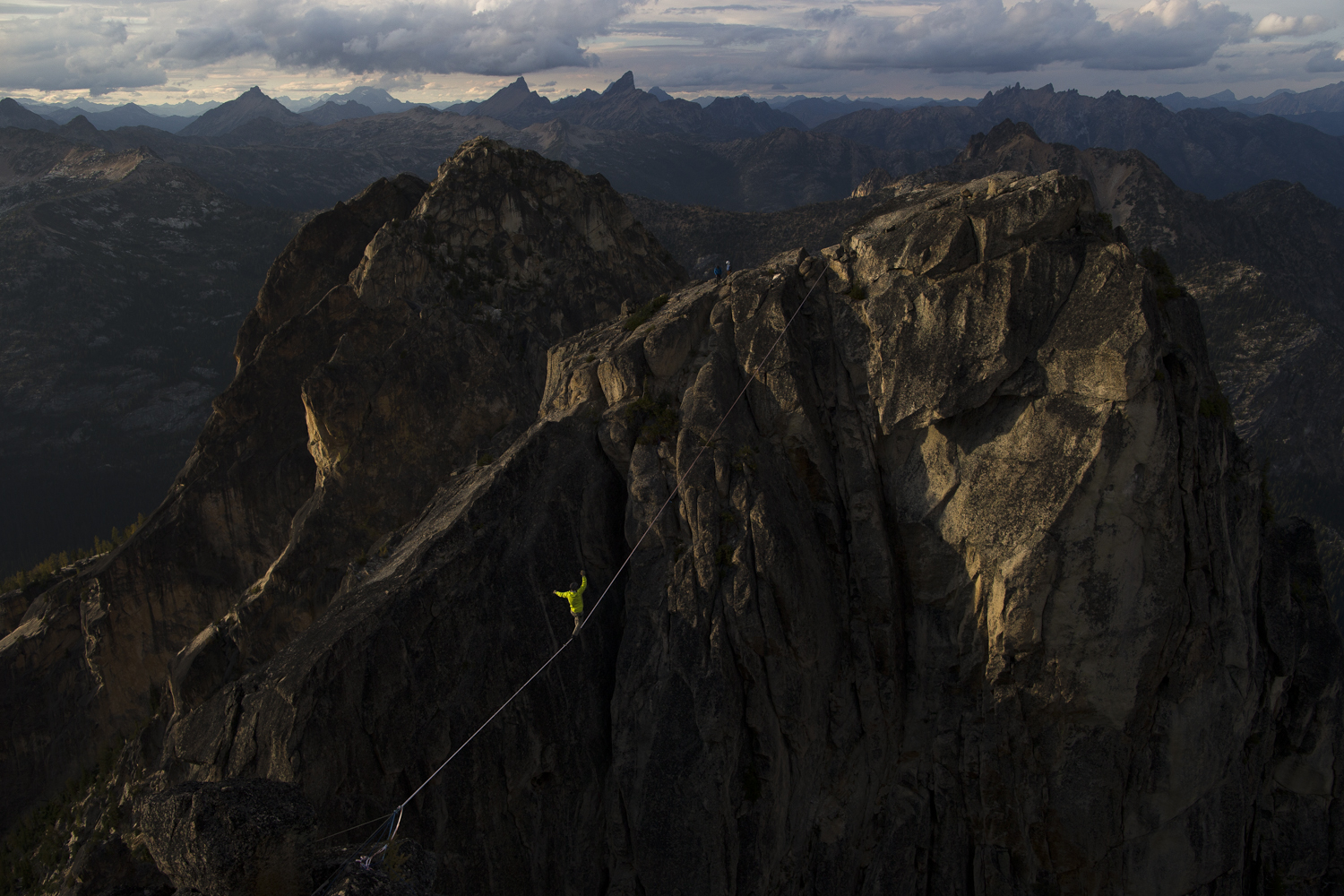 Ben Plotkin-Swing walks across a highline in the North Cascades. Plotkin-Swing says his companion Carl Marrs played a large role in getting the line rigged.  (Courtesy of Krystle Wright)